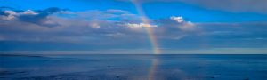 Rainbow over the water representing how a health psychologist can help you find meaning and purpose through counseling with a psychologist.