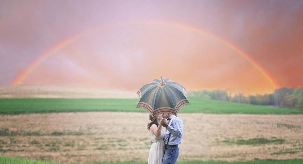 Couple kissing under rainbow | Couples & Marital Therapy | Wellness Psychological Services | Florida