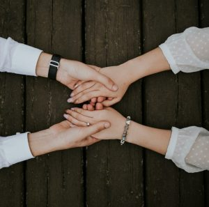 A top down view of a couple joining hands. This represents couples therapy in Tampa, FL, and the support a couples therapist in Saint Petersburg, FL can offer. Learn more about couples counseling in Tampa, FL today. 33704   33703   33609